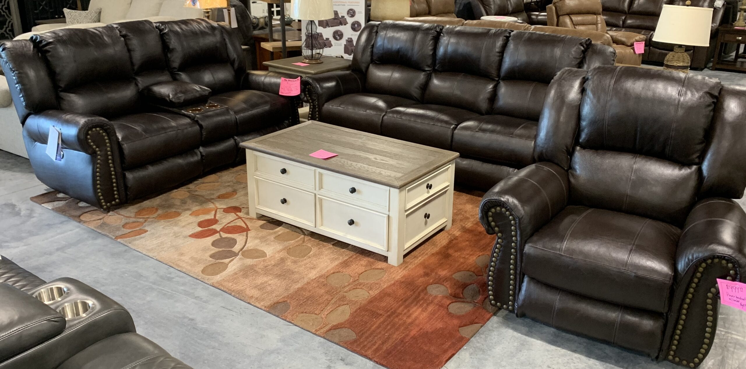 Catnapper: a leather power reclining sofa, loveseat, and matching power leather recliner.